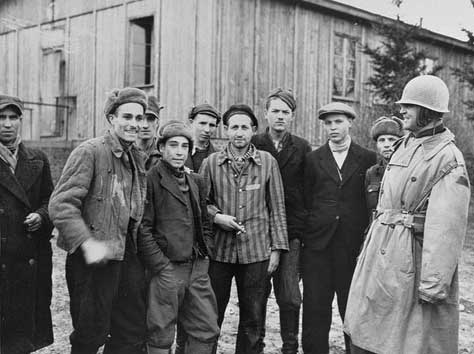 Colonel Hayden Sears poses with survivors of Ohrdruf